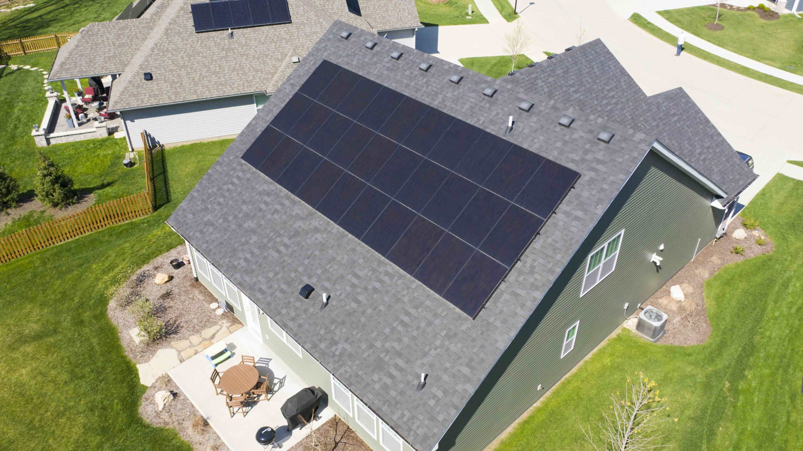 The rear of a Columbia, Missouri home has a perfectly lined up field of solar panels capturing the power of the sun.