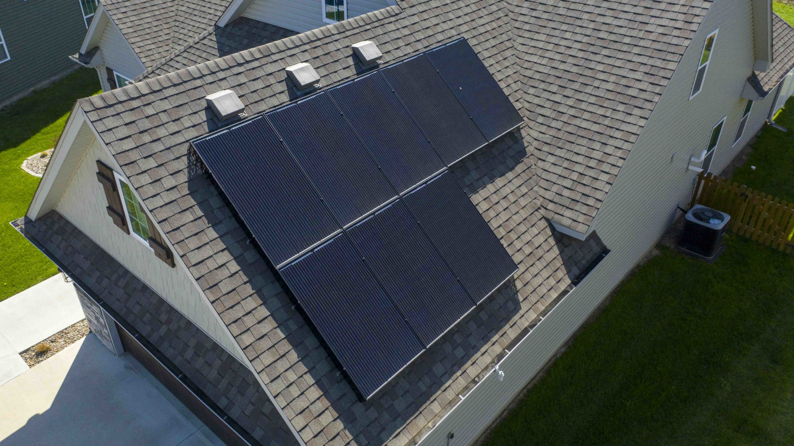 Even the garage roof on this southwest Columbia home has solar panels. The black panels look great on this dark roof.