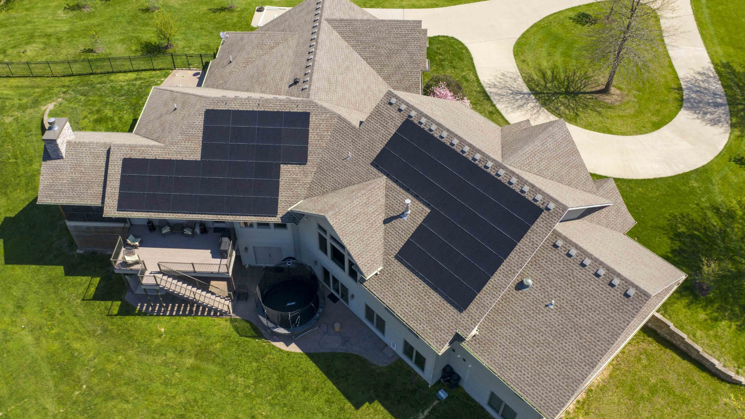 Large home in Columbia, Missouri is seen from the sky with solar panels. Boone County solar install by Dogwood Solar.