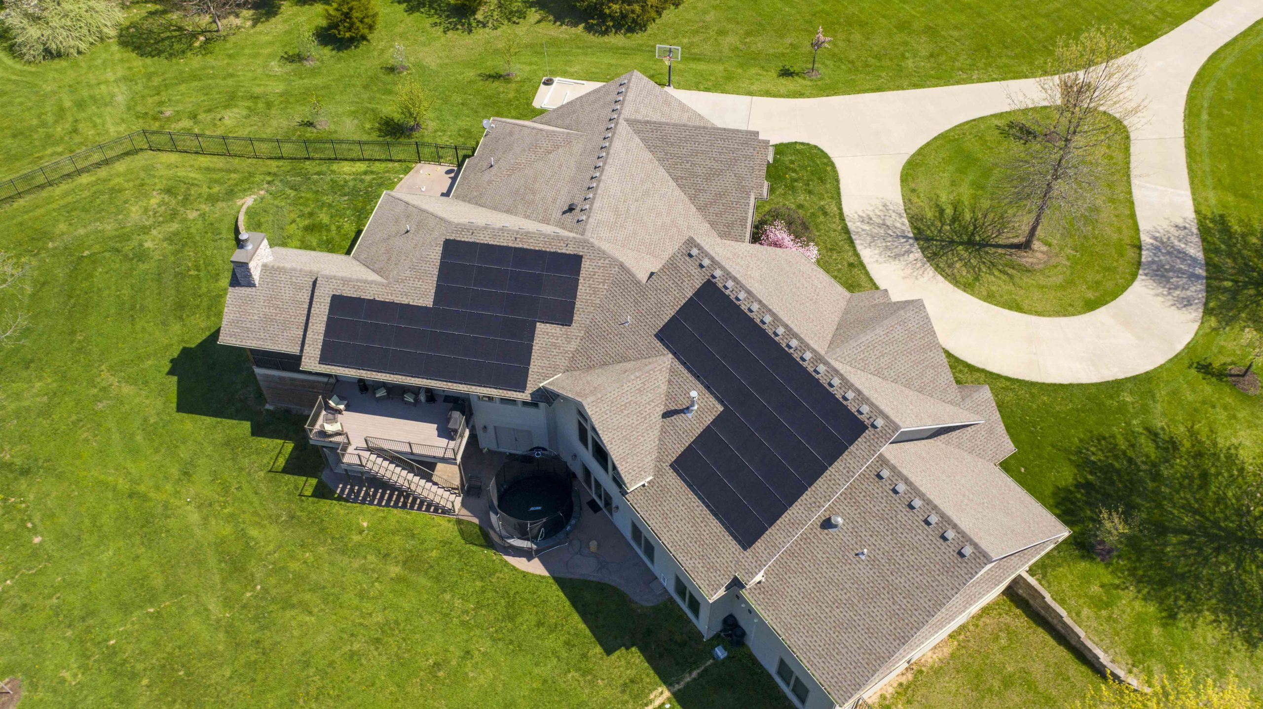 Black solar panels are neatly arranged on this Boone County home. Solar system installation was completed by Dogwood Solar.